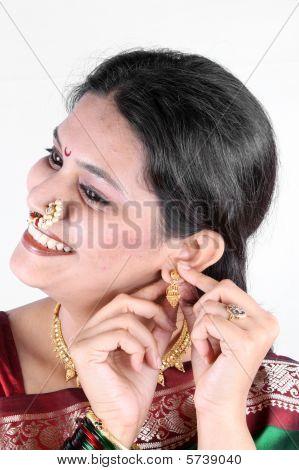 Wearing Gold Earring