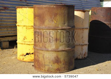 Abandoned fifty five gallon drums