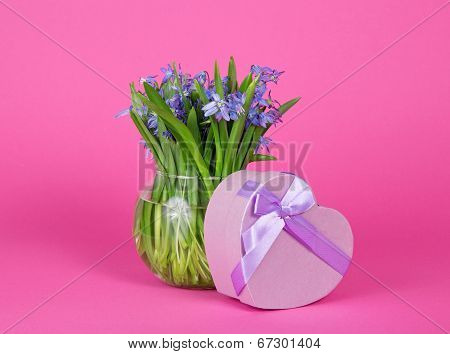 Gift box heart with ribbon and vase