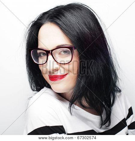 Beautiful young expression  brunette woman wearing glasses. Studio shot.