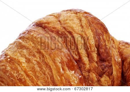 closeup of an appetizing croissant on a white background