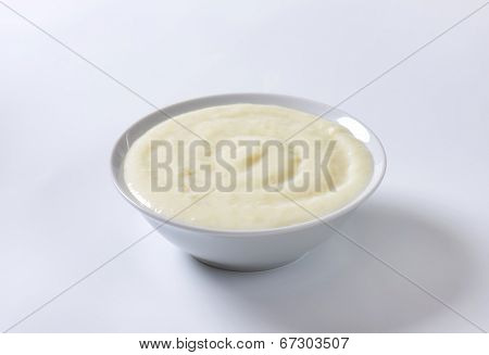 pure semolina pudding served in the white bowl