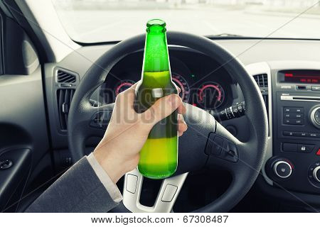 Man Holding Bottle Of Beer While Driving Car