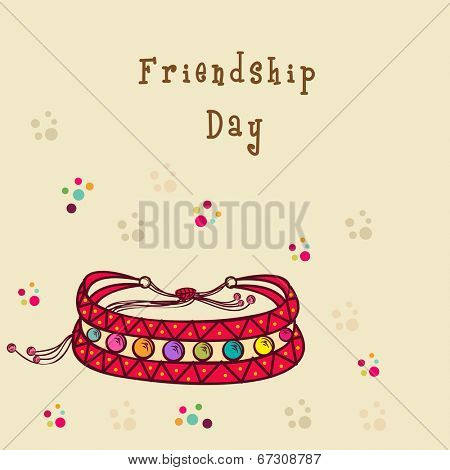 Stylish friendship bands on colorful dots decorated beige background for Happy Friendship Day.
