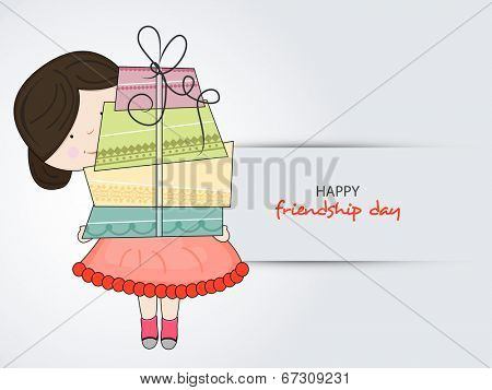 Cute little boy holding big gift boxes on grey background for Happy Friendship Day celebrations.