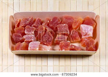 Candied Fruits In Wooden Box On Straw Mat
