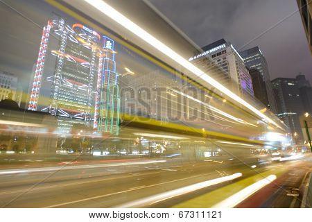 HONG KONG - APRIL 21: Hong Kong downtown skyscrapers at night on April 21, 2014 in Hong Kong, China. Hong Kong alternatively known by its initials H.K., is situated on China's south coast.