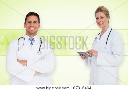 Composite image of happy medical team against medical background with green ecg line