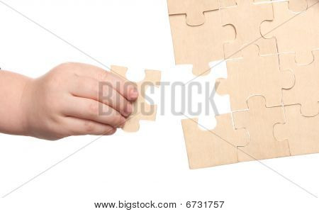 Mens And Childs Hands Finishing Puzzles