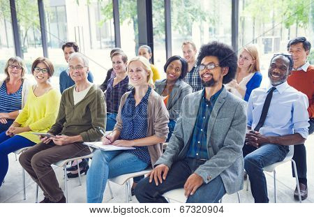 Multi-Ethnic Group of People in Seminar
