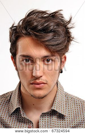 Young man with particular hair style portrait.