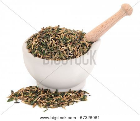 Lotus flower plumule chinese herbal medicine in a stone mortar with pestle over white background. Lian zi xin.