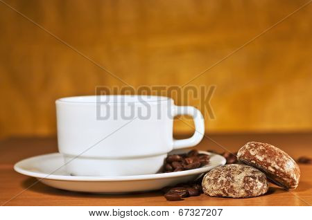 White Cup Of Coffee On A Saucer And Cakes