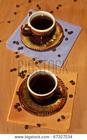 Two Black Cups Of Coffee On Napkins