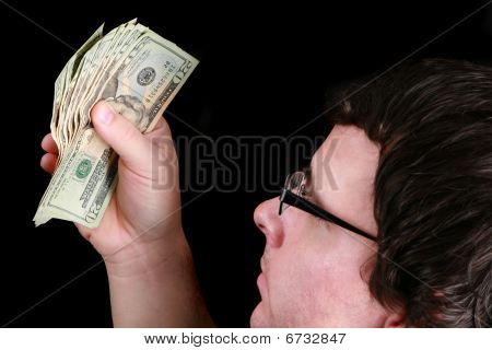 Young Man Holding A Fist Full Of Money