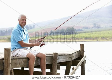 Senior man fishing on jetty
