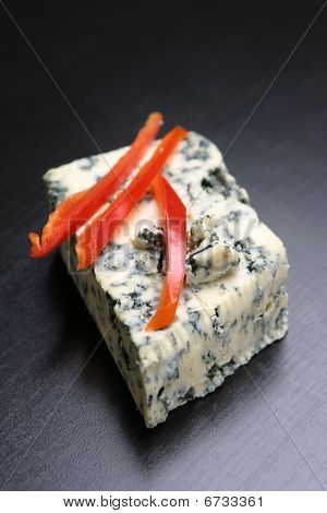 Red pepper slices on cheese