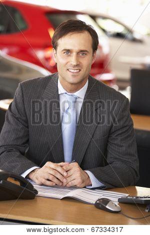 Man working in car showroom