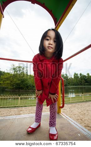 A Little Girl Spending Her Free Time On The Playground