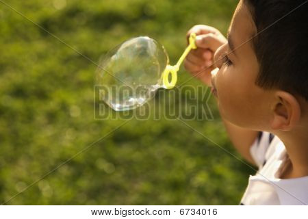 Young Boy Blowing Bubbles