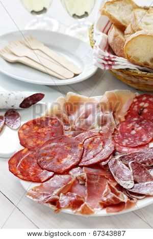 various types of  spanish salami, sausage and ham. fuet galidad, jamon serrano, chorizo, salchichon and jamon iberico