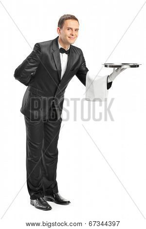 Full length portrait of a professional waiter holding a tray isolated on white background