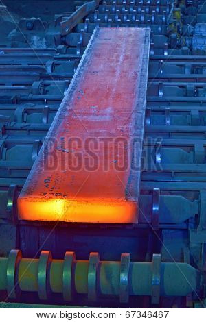 hot steel on conveyor inside of steel plant