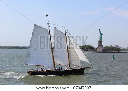 Tall ship next to Statue of Liberty in New York