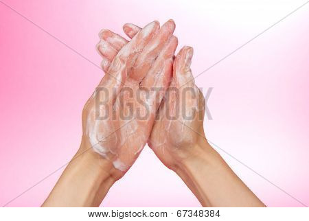 Foam of soap on female hands