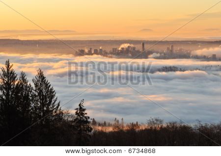 Downtown Vancouver In A Foggy Sunrise