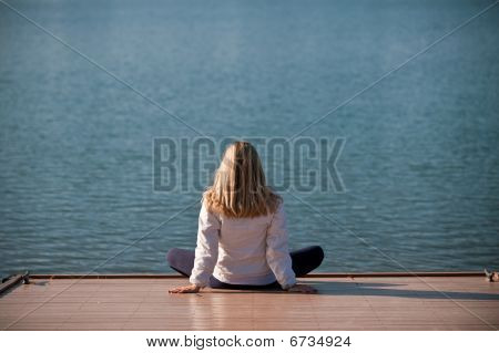 Woman by lake