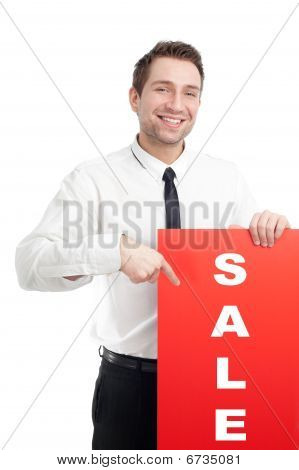 Young Businessman holding red blank sign and smiling isolated on white.