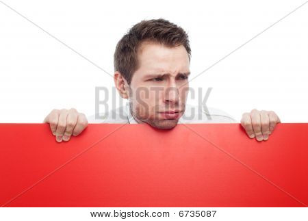 Young Man Holding Red Blank Sigh Sneering