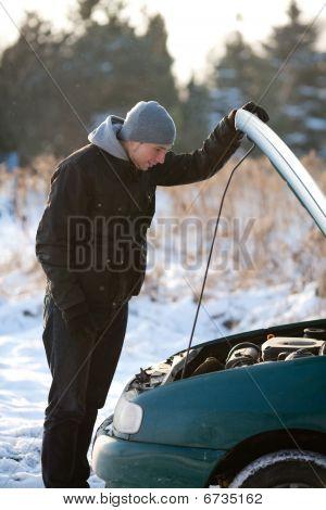 Man With Broken Car In Winter