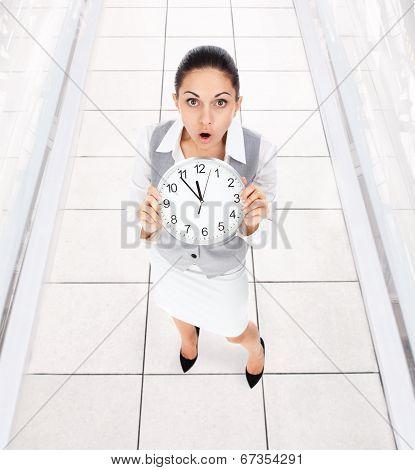 Businesswoman clock worried