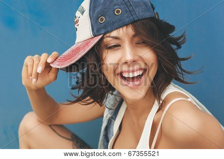 Young Brunette Woman In Cap