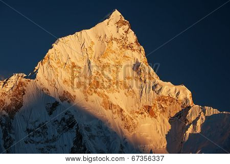 Scene Of Sunset On Mountain Peaks