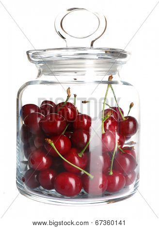 Cherries in glass jar isolated on white