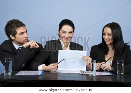 Business People Show Financial Chart At Meeting
