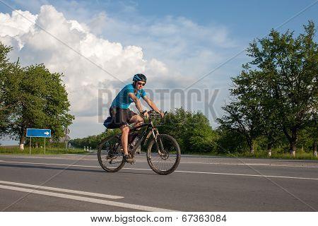 Man Cycling At The Road