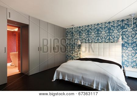 interior of a modern villa, beautiful bedroom with double bed
