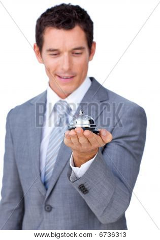 Attractive Caucasian Businessman Showing A Service Bell