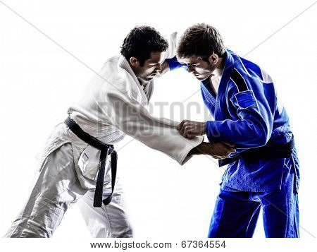 two judokas fighters fighting men in silhouette on white background