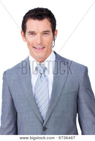 Confident Male Executive With Headset On