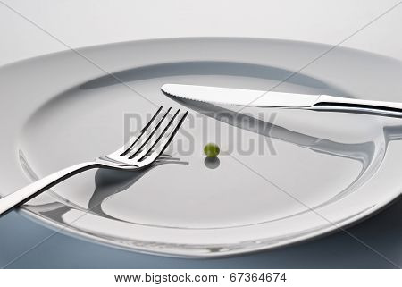 Plate With Cutlery And A Pea