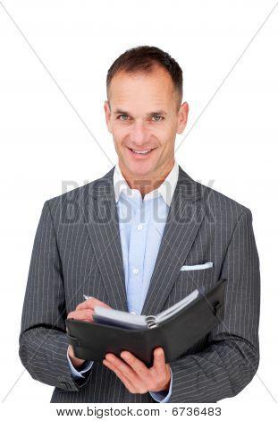 Assertive Businessman Holding An Agenda