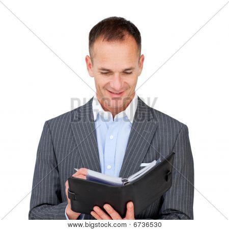 Self-assured Businessman Consulting His Agenda