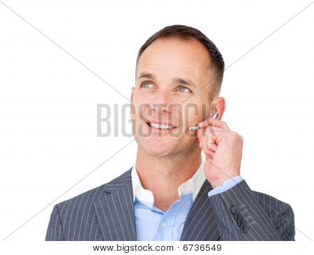 Mature Customer Service Agent Talking On Headset