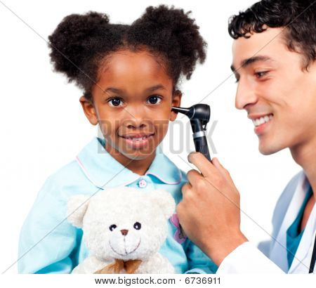 Smiling doctor examining his patient's ears