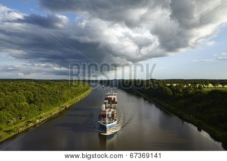 Beldorf - Container Vessel At Kiel Canal Under Shelf Cloud
